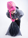 Funny thief with pink tights on his head holding a stolen bag face Stock Images
