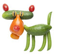 Funny tiger made of tomato and cucumber Royalty Free Stock Photo