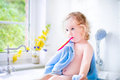 Funny toddler girl brushing her teeth Royalty Free Stock Photo