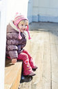 Funny toddler girl sitting outdoors Royalty Free Stock Photos