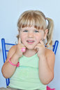 Funny toddler wearing ring and bracelet Stock Photography