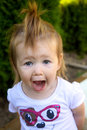 Funny toddler a young female making faces Royalty Free Stock Photos