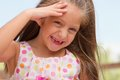 Funny toothless little girl outdoors Stock Photo