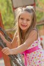 Funny toothless little girl on a playground Royalty Free Stock Photos