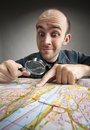 Funny tourist discovering map Royalty Free Stock Photo