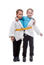Funny twin brothers pretending siamese in studio isolated on white Stock Photography