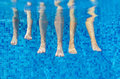 Funny underwater family legs in swimming pool Royalty Free Stock Photo