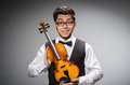 Funny violin player with fiddle Stock Photography