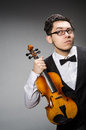 Funny violin player with fiddle Royalty Free Stock Photos