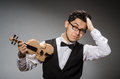 Funny violin player with fiddle Stock Image