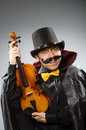 The funny violin player wearing tophat