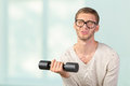 Funny weak man tries to lift a weight Stock Photo
