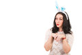 Funny woman with bunny ears gesticulate isolated on white background copy space for text message in left part of image Stock Images