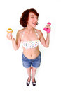 Funny woman with dumbbells and cake Stock Images
