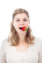 Funny woman eating strawberry Stock Photography