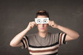 Funny woman looking with hand drawn paper eyes Royalty Free Stock Photo