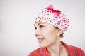 Funny woman wearing pajamas and bathing cap Royalty Free Stock Photo