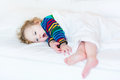 Funny yawning toddler girl taking nap in white bed Royalty Free Stock Photo