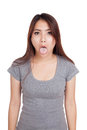 Funny young asian woman sticking out tongue isolated on white background Stock Images