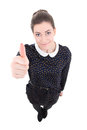 Funny young beautiful business woman in black dress thumbs up is Stock Photography