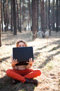 Funny young girl with laptop outdoors Royalty Free Stock Photo