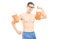 Funny young man with swimming arm bands isolated on white background Royalty Free Stock Photos