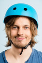 Funny young man wearing cycling helmet smiling Royalty Free Stock Photo