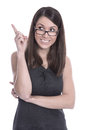 Funny young woman with glasses is presenting with her finger businesswoman showing something forefinger Stock Photos