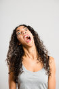 Funny young woman pulling faces Stock Photography