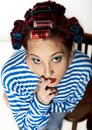 Funy housewife with curlers smokes a cigarette. smoking break for lady. free space for your text