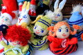 Fur caps dolls for children colored from wool material residue Stock Image