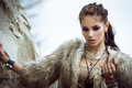 Fur coat and flash tattoos portrait of a beautiful lady with tottoos posing outdoors near the sea Stock Images