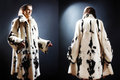 Fur coat winter clothes fashion mature woman in white mink spotty Stock Photo