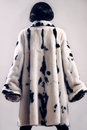 Fur coat winter clothes fashion woman in white mink spotty Royalty Free Stock Photography