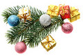 Fur-tree branch, Christmas spheres and gifts Stock Photo