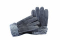 Fur winter gloves grey colors on the white background warm made of natural presented a Stock Photos