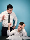 Furious boss concept illustrating problems at work between bosses and employees Royalty Free Stock Photo
