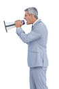 Furious businessman shouting in loudspeaker on white background Royalty Free Stock Image