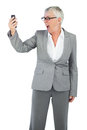 Furious businesswoman screaming during a call on white background Royalty Free Stock Photography