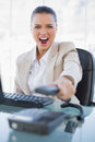 Furious businesswoman screaming while hanging up the phone in bright office Royalty Free Stock Images