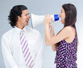 Furious businesswoman yelling through a megaphone Royalty Free Stock Photo