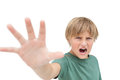Furious little boy shouting and making stop sign with hand on white background Stock Photo