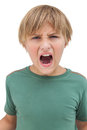 Furious little boy shouting on white background Stock Photo