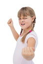 Furious little girl showing her fist on white background Royalty Free Stock Image