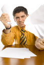 Furious man crumpling papers Stock Images
