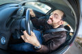 A furious man driving shot with a very wide fisheye lens and treated with a motion blur effect Royalty Free Stock Photo