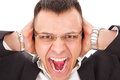 Furious man yelling with glasses holding hands on his ears Royalty Free Stock Image