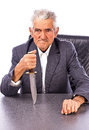 Furious senior with a knife looking at camera isolated on white background Royalty Free Stock Photography