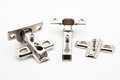 Furniture door hinge connectors on white background Stock Image