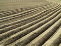Furrows field with deep the plowed soil of agricultural land Royalty Free Stock Images